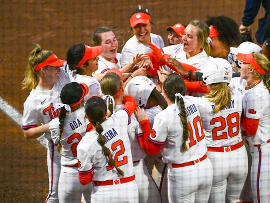 Clemson's Valerie Cagle (72) is congratulated by teammates after her two-run home run against Western Carolina Wednesday night in the bottom of the first inning in the second game of a doubleheader. Clemson won 8-0.