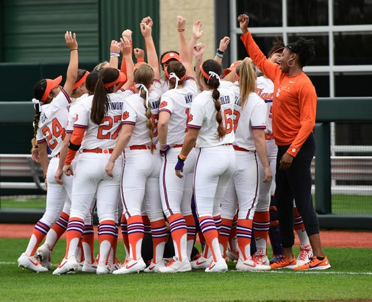 Clemson softball players huddle before the inaugural season home opener with Western Carolina at Clemson Softball Stadium in Clemson February 12, 2020.