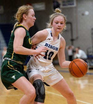 In this photo from a 2020 Crosstown basketball game, Great Falls High's Taylor VanderMars works in the post against CMR's Chloe Pace.