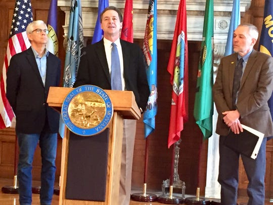 Gov. Steve Bullock discusses the earned-income tax credit Wednesday at the state Capitol. He is joined by Lt. Gov. Mike Cooney, left, and Gene Walborn, Montana Department of Revenue director.