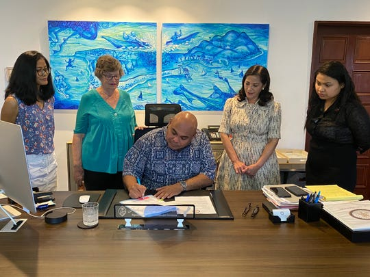 Acting Gov.Joshua Tenorio signed Bill 102into Public Law 35-67 to strengthen Guam's law for victims of revenge porn.