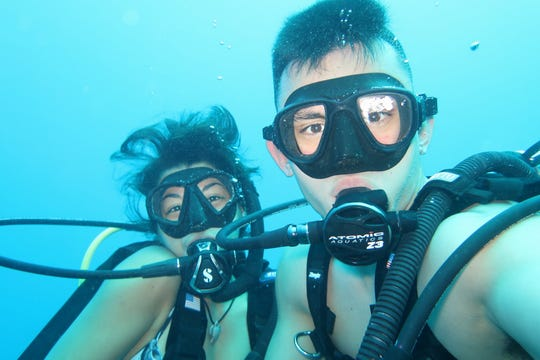 William Naden and Leilani Sablan count snorkeling, diving, boat cruising and spearfishing as their favorite activities.