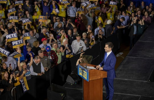 Pete Buttigieg talks with supporters and media members at a primary night watch party at Nashua Community College on Feb. 11.
