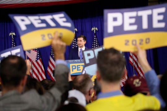 Democratic presidential candidate Pete Buttigieg speaks to supporters at a primary night election rally in Nashua, N.H.