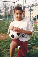 Soccer was George Hill's first love. He is shown here in the 1990s on a Tab Rec team.