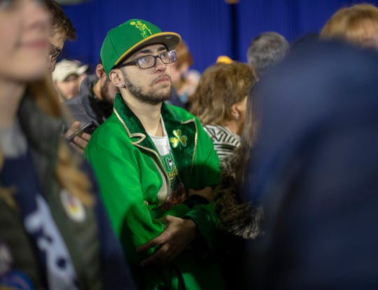 Louis Alciere, Hudson, N.H., watches early returns on a large television at a Pete Buttigieg primary night watch party at Nashua Community College in Nashua, Tuesday, Feb. 11, 2020.