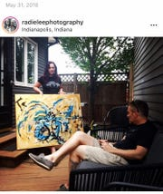 Artists Radie, left, and Evan Steiner are shown on Radie's Instagram page with a work by Evan.