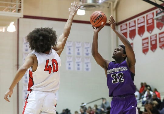 Pike Red Devils forward Justin Dobbins (40) is unable to stop a three-point shot by Brownsburg Bulldogs Malek Edmonds (32) during the third quarter of the game at Pike High School in Indianapolis on Tuesday, Feb. 11, 2020. Brownsburg won, 61-55.