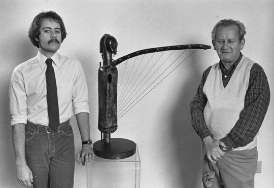 Phil and Mauricio Lasansky with an African fang harp, 1976