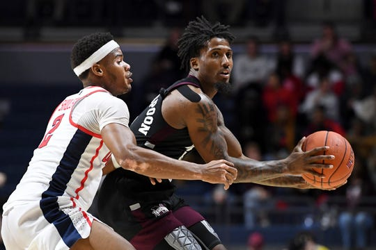 Mississippi State forward Elias King (2) looks for room past Mississippi guard Devontae Shuler (2) during the first half of an NCAA college basketball game in Oxford, Miss., Tuesday, Feb. 11, 2020. (AP Photo/Thomas Graning)