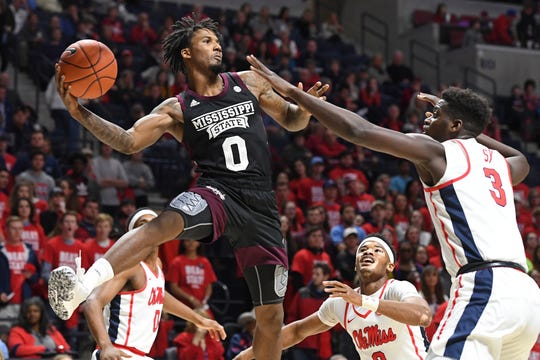 Mississippi State guard Nick Weatherspoon (0) passes the ball as Mississippi forward Khadim Sy (3) guards during the first half of an NCAA college basketball game in Oxford, Miss., Tuesday, Feb. 11, 2020. (AP Photo/Thomas Graning)