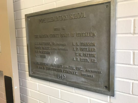 A plaque commemorating the building of the old part of Pope Elementary School  in 1949.