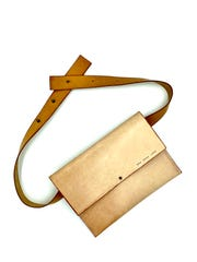 "Honeymouth belt bag. ""My current line of bags has a subtle but bright red edge that adds some flair and some fun, but not so much that it can't be your everyday bag,"" said creator Georgia Vogel."