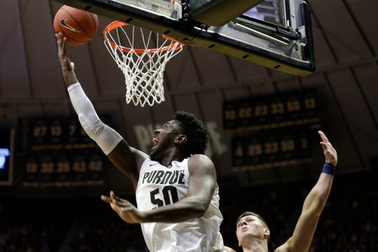 Purdue forward Trevion Williams (50) hooks a layup into the basket during the first half of a NCAA men's basketball game, Tuesday, Feb. 11, 2020 at Mackey Arena in West Lafayette.