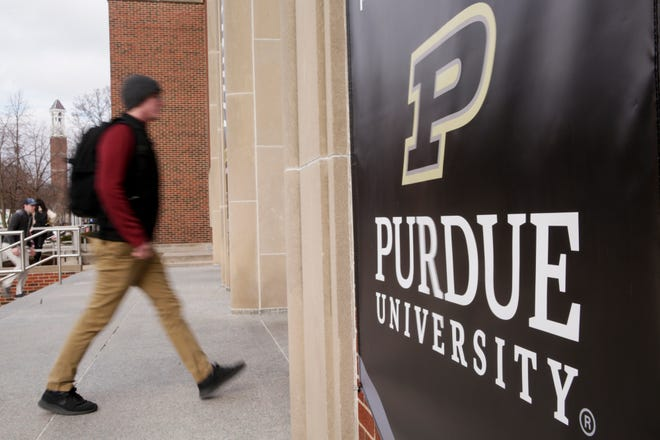 Purdue's new logo, which incorporates the 'Motion P' used by athletics along with the name of the university, is incorporated into a banner that hangs on the west entrance to the Stewart Center at Purdue University, Tuesday, Feb. 11, 2020 in West Lafayette.