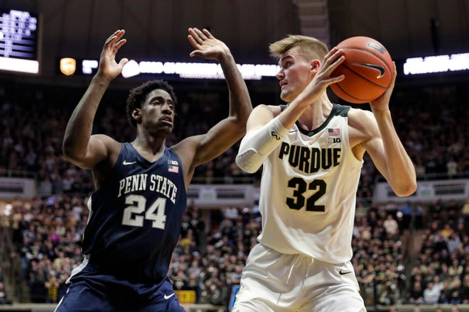 Purdue center Matt Haarms (32) shoots over Penn State forward Mike Watkins (24) during the second half of an NCAA college basketball game in West Lafayette, Ind., Tuesday, Feb. 11, 2020. Penn State defeated Purdue 88-76. (AP Photo/Michael Conroy)