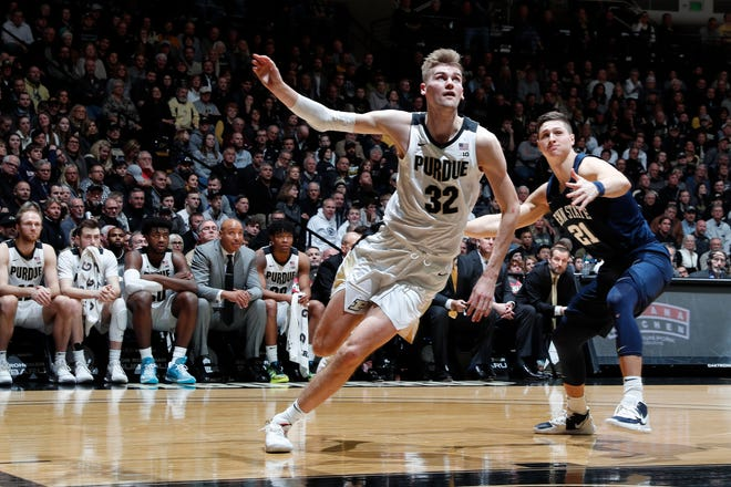 Feb 11, 2020; West Lafayette, Indiana, USA;  Purdue Boilermakers center Matt Haarms (32) pursues a rebound against Penn State Nittany Lions forward John Harrar (21) during the second half at Mackey Arena. Mandatory Credit: Brian Spurlock-USA TODAY Sports