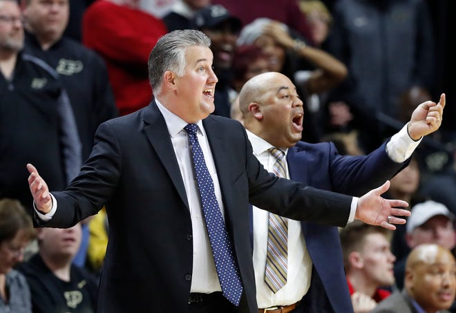 Purdue head coach Matt Painter, left, and assistant coach Micah Shrewsberry gestures to their players during the second half of an NCAA college basketball game against Rutgers, Tuesday, Jan. 28, 2020, in Piscataway, N.J. (AP Photo/Kathy Willens)
