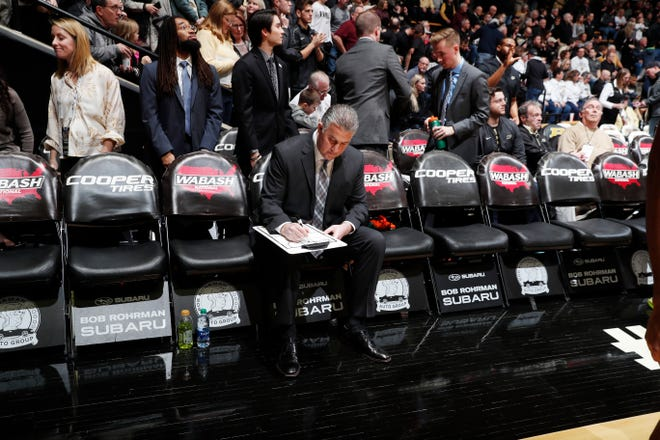Feb 11, 2020; West Lafayette, Indiana, USA;  Purdue Boilermakers coach Matt Painter writes on his clip board before the game against the Penn State Nittany Lions at Mackey Arena. Mandatory Credit: Brian Spurlock-USA TODAY Sports