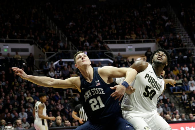 Penn State forward John Harrar (21) boxes out Purdue forward Trevion Williams (50) during the second half of a NCAA men's basketball game, Tuesday, Feb. 11, 2020 at Mackey Arena in West Lafayette.