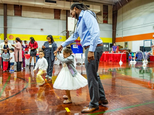 Kendrick Thompson dances with his daughter Laiken Thompson at the Valentine's Day Sweetheart Dance at the Truman Early Childhood Education Center Tuesday, Feb. 11, 2020.