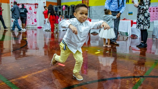 Javeon Davis dances to the music at the Valentine's Day Sweetheart Dance at the Truman Center for Early Childhood Education Center Tuesday, Feb. 11, 2020.