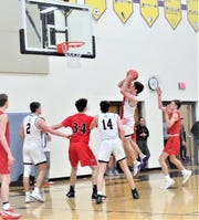 Bloom-Carroll's Evan Dozer takes a shot in the lane against Fairfield Union Tuesday night. The Bulldogs pulled out a 52-49 overtime thriller.