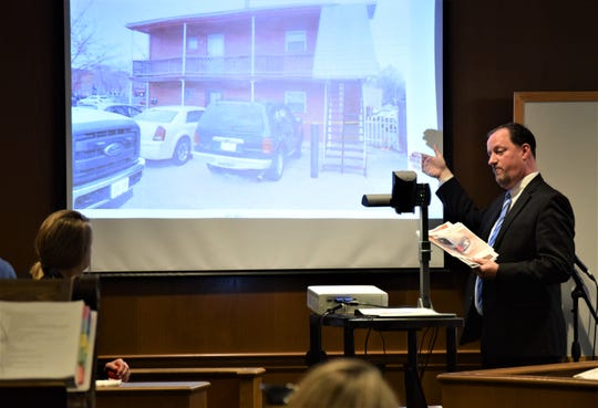 Brian Waltz, assistant prosecutor with the Fairfield County Prosecutor's Office, indicates a vehicle in a photograph to Kassaundra Phillips, seated, during the jury trial for Chad Kerens. Kerens is accused of murdering one man and attempting to tamper with evidence at the scene.