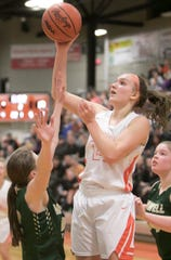 Brighton's Sophie Dziekan scores two of her game-high 22 points in a 64-40 victory over Howell on Tuesday, Feb. 11, 2020.