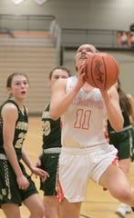Elaine Halonen of Brighton drives to the basket for two of her career-high 17 points in a 64-40 victory over Howell on Tuesday, Feb. 11, 2020.