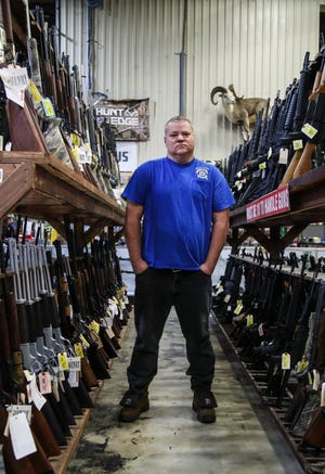 "John Cartwright of Kentucky United cannot legally possess a gun because of a past felony conviction. In 2012, he pleaded guilty to multiple counts of defrauding a secured creditor, court records show. ""I can't own a gun … but it doesn't mean I don't believe in something,"" he said. ""I can fight for other people's freedoms whether I have them or not."" He visited Kentucky Gun Co. in Bardstown."