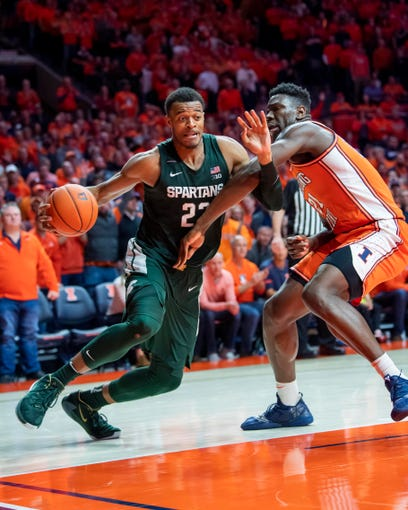 Feb 11, 2020; Champaign, Illinois, USA; Michigan State Spartans forward Xavier Tillman (23) drives against Illinois Fighting Illini center Kofi Cockburn (21) during the second half at State Farm Center. Mandatory Credit: Patrick Gorski-USA TODAY Sports
