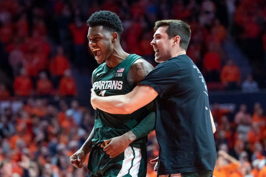 Feb 11, 2020; Champaign, Illinois, USA; Michigan State Spartans guard Rocket Watts (left) celebrates after the second half against the Illinois Fighting Illini at State Farm Center. Mandatory Credit: Patrick Gorski-USA TODAY Sports