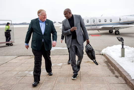 Michigan State's new head football coach Mel Tucker, right, and MSU Athletic Director Bill Beekman talk after Tucker  arrived on Wednesday, Feb. 12, 2020, at the Capital Region International Airport in Lansing.
