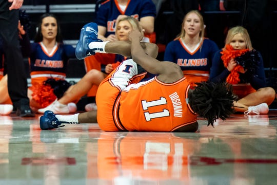 Feb 11, 2020; Champaign, Illinois, USA; Illinois Fighting Illini guard Ayo Dosunmu (11) reacts after a last second game injury against the Michigan State Spartans at State Farm Center. Mandatory Credit: Patrick Gorski-USA TODAY Sports