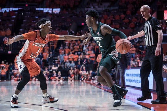 Illinois' Trent Frazier (1) pressures Michigan State's Rocket Watts (2) in the second half of an NCAA college basketball game Tuesday, Feb. 11, 2020, in Champaign, Ill. (AP Photo/Holly Hart)