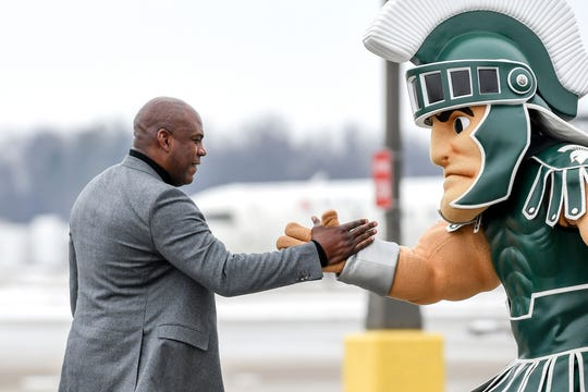 Michigan State's new head football coach Mel Tucker is greeted by Sparty on Wednesday, Feb. 12, 2020, at the Capital Region International Airport in Lansing.