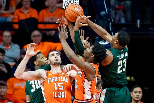 Feb 11, 2020; Champaign, Illinois, USA; (left to right) Michigan State Spartans forward Marcus Bingham Jr. (30) and forward Xavier Tillman (23) battle for a rebound against Illinois Fighting Illini forward Giorgi Bezhanishvili (15) and guard Andres Feliz (10) during the first half at State Farm Center. Mandatory Credit: Patrick Gorski-USA TODAY Sports