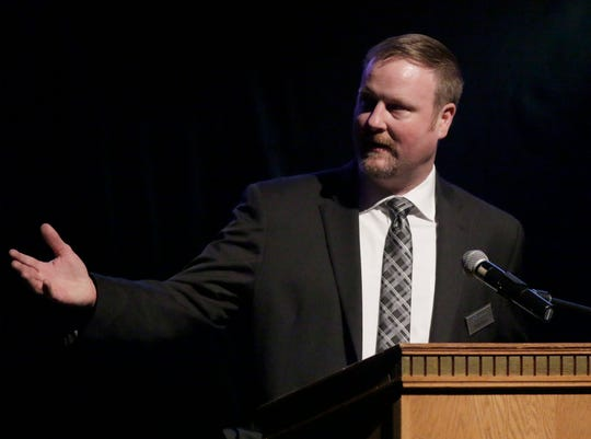 FILE - Holy Family Memorial's Brett Norell speaks on behalf of Lakeshore Memory Clinic during The Chamber of Manitowoc County's Awards of Distinction Feb. 11, 2020, at the Capitol Civic Centre in Manitowoc.