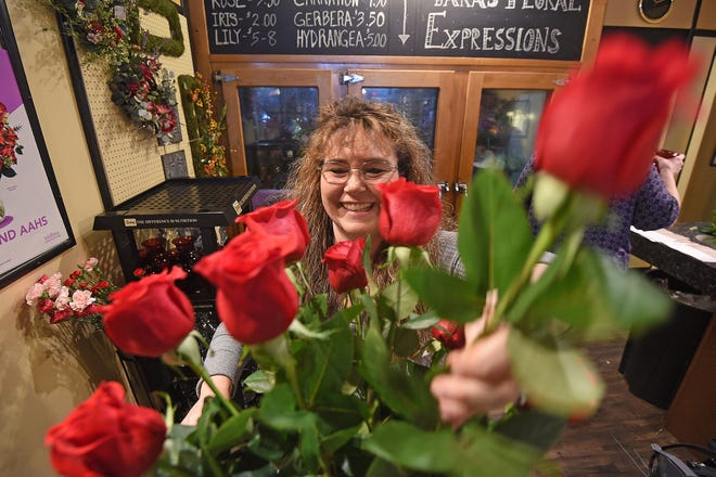 Tara Beaire, the owner of Tara Floral Expressions, enjoys creating a red rose bouquet for the Valentine's Day rush.