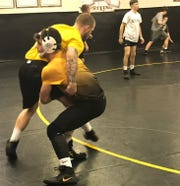 Duke-bound Conor Becker, a 2019 state champion for Northmor, drills with assistant coach Jeremiah Howe during practice Tuesday.