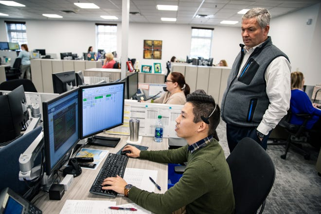 Mike Murphy watches Sam Hong work in Cornerstone Systems' Intermodal Operations Department in Memphis. Both are intermodal account coordinators for the third-party logistics provider.