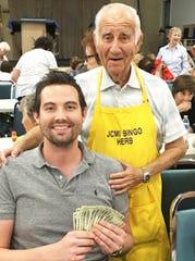 JCMI Bingo winner Eric Chesser with Dr. Herb Kern.