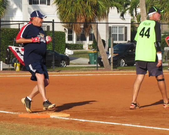 Jim Ramage pulls up at first base on a hit as Speakeasy's Grady Fuller steps off covering first base.