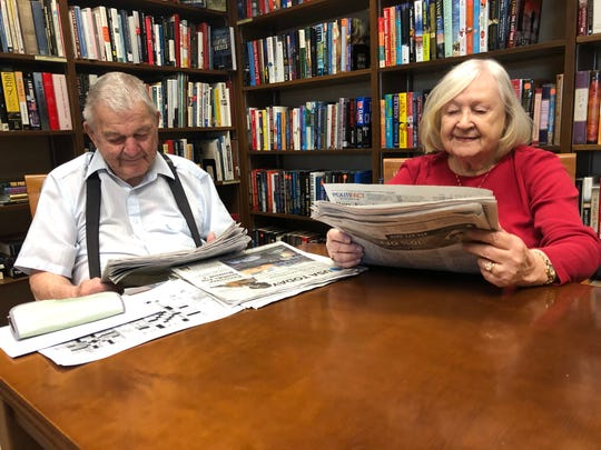 Barb and Cliff Hohlstein enjoy reading in the library of the Harwood Place in the afternoon.