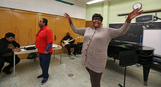 "Mary Elizabeth Coleman, right, helps energize the ensemble cast during one of their songs as they practice for the ""We Are The Drum""  production at Marshall High School. Also pictured, from left, are Patricia Bridges, director; Kevin Williams, executive director for Capita; and Lannie Harmon, on guitar."