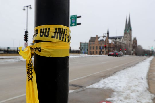 Police tape remains at the scene near North 10th Street and West Wisconsin Avenue in Milwaukee on Wednesday where Marquette University College of Business Administration Dean Joe Daniels was killed when he was struck by a vehicle Tuesday night.
