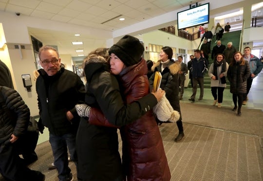 People hug after a prayer service for Marquette University College of Business Administration Dean Joe Daniels at the Alumni Memorial Union on Wednesday.  Daniels was killed when he was struck by a vehicle Tuesday night while crossing the intersection of North 10th Street and West Wisconsin Avenue.