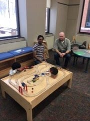 Phonendra Potineni (left) and Andrew Potineni use the library resources at the Sensory-Friendly Sunday program Feb. 9 at the Germantown Community Library. Sensory-Friendly Sundays is held every other month to benefit families with autism.