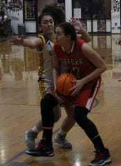 Norfork's Kynzie Rangel muscles her way in for two against Concord's Abi West on Tuesday night at Concord.